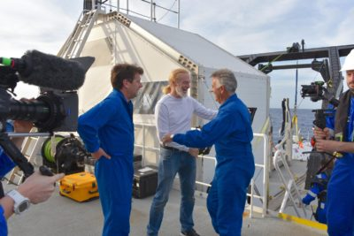 Victor Vescovo congratulates Patrick Lahey and Dr Alan Jamieson following their Science dive in the Java Trench